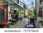 alley with tourist restaurants... | Shutterstock . vector #717573610