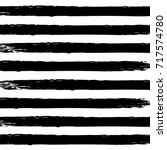 black watercolor stripes on a... | Shutterstock .eps vector #717574780