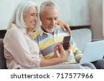 overjoyed aged couple using... | Shutterstock . vector #717577966