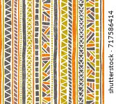 Seamless striped pattern. Ethnic and tribal motifs. Vintage print, grunge texture.Simple ornament. Handmade. Orange, green, gray and white colors. Vector illustration. | Shutterstock vector #717586414