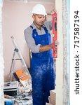 professional builder in helmet...   Shutterstock . vector #717587194