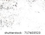 dark brown grunge background.... | Shutterstock . vector #717603523