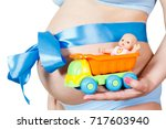 pregnant woman's belly closeup... | Shutterstock . vector #717603940