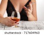woman alcoholism is social... | Shutterstock . vector #717604963