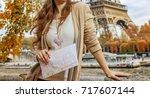 autumn getaways in paris. young ... | Shutterstock . vector #717607144