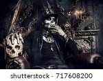 halloween. a man with a skull... | Shutterstock . vector #717608200