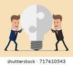 two businessmen unite lamp of... | Shutterstock .eps vector #717610543