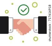 handshake of business partners. ...   Shutterstock .eps vector #717616918