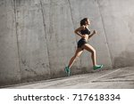 female sport runner striving... | Shutterstock . vector #717618334