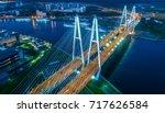 a big bridge over the river.... | Shutterstock . vector #717626584