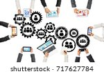group of people with devices in ...   Shutterstock . vector #717627784