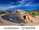 "Small photo of ANCIENT PATARA, LYCIA, TURKEY- May 11, 2016. The Assembly Hall (""Vouleuterion"") of the Lycian League at ancient Patara, Lycia, Antalya province, Turkey"