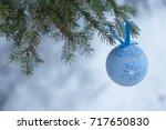 A Blue Fur Tree Toy On A Branc...