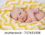 cute newborn baby in the blanket | Shutterstock . vector #717651508