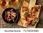 fried chantarelle onion toasts... | Shutterstock . vector #717654580