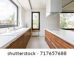 modern kitchen with white... | Shutterstock . vector #717657688