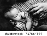 father's hand holding baby boy... | Shutterstock . vector #717664594