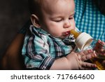 father's hand holding baby boy... | Shutterstock . vector #717664600