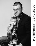 studio portrait of father and... | Shutterstock . vector #717665800