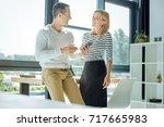 happy joyful colleagues laughing | Shutterstock . vector #717665983