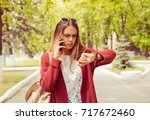 late. woman angry looking at... | Shutterstock . vector #717672460
