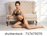 gorgeous dark haired woman with ... | Shutterstock . vector #717675070