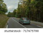 cars driving on the asphalt... | Shutterstock . vector #717675700