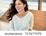 beautiful smiling woman in the... | Shutterstock . vector #717677470