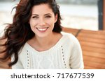 beautiful smiling woman in the... | Shutterstock . vector #717677539