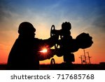 the oil workers are working | Shutterstock . vector #717685768