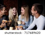 four friends laughing | Shutterstock . vector #717689620