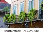 scenic wrought iron balcony | Shutterstock . vector #717693730
