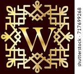 ethnic monogram frame  gold... | Shutterstock . vector #717699268