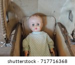 vintage baby doll in a carriage | Shutterstock . vector #717716368