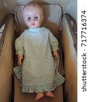 vintage baby doll in an old... | Shutterstock . vector #717716374