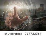 hand of businessman touching... | Shutterstock . vector #717723364