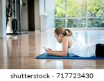 asian woman relaxing with smart ... | Shutterstock . vector #717723430