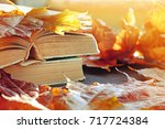 autumn background. books on the ... | Shutterstock . vector #717724384