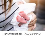 closeup of newborn baby | Shutterstock . vector #717734440