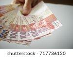 hong kong dollar banknotes  | Shutterstock . vector #717736120