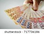 hong kong dollar banknotes  | Shutterstock . vector #717736186