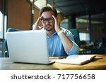 businessman feeling headache... | Shutterstock . vector #717756658