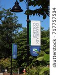 Small photo of BURLINGTON, VERMONT - August 27, 2017: Lamp post with banners at Champlain College on S. Willard Street in Burlington. Editorial use only.