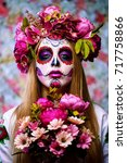 Stock photo dia de los muertos day of the dead woman with sugar skull makeup on a floral background calavera 717758866