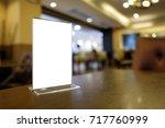 mock up menu frame standing on... | Shutterstock . vector #717760999