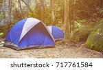 blue camping tent at... | Shutterstock . vector #717761584