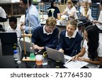 group of students laboratory... | Shutterstock . vector #717764530