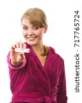 happy delighted woman wearing... | Shutterstock . vector #717765724