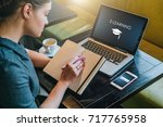 young woman student sitting at... | Shutterstock . vector #717765958