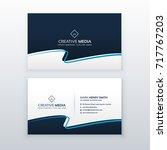 modern blue wavy business card... | Shutterstock .eps vector #717767203